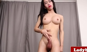 Busty ladyboy stroking and tugging her cock